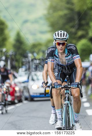 Col du Tourmalet France - July 24 2014: The Dutch cyclist Niki Terpstra of Team Omega Pharma-Quick Step climbing the difficult road to Col du Tourmalet in Pyrenees Mountains during the stage 18 of Le Tour de France 2014.