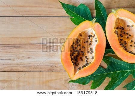 Ripe Papaya On Wood Table From Above , Ripe Papaya Health Benefits.