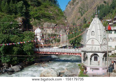 Sikh Gurudwara and a bridge across the river Parvati in the Himalayas. North India