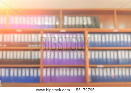 Blurred book in the library or Abstract book on bookstore with shelf floor background