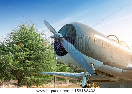 Abandoned old fighter airplane on the ground