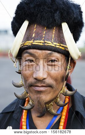 KOHIMA, NAGALAND/INDIA - DECEMBER 1, 2013: Tribes of Nagaland show their traditional tribal costumes at the annual Hornbill festival. The Hornbill is also known as the Festival of Festivals'.