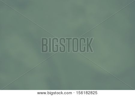 background of green color monotonous smooth texture of matte paper