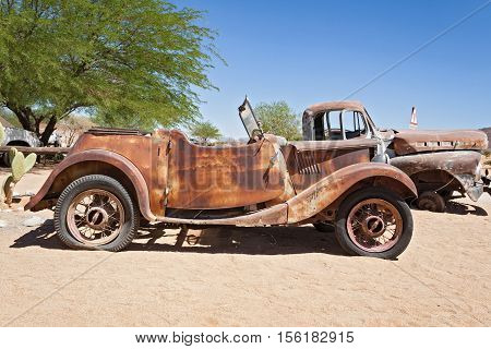 SOLITAIRE, NAMIBIA-NOVEMBER 26, 2015: Damaged abandoned car at the service station Solitaire, Namibia