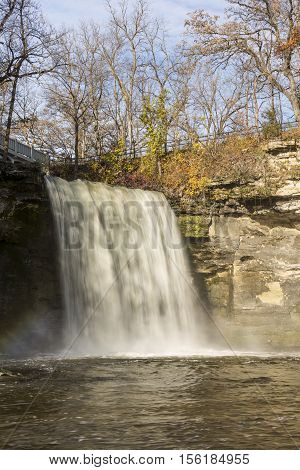 A waterfall on the Minneopa River during autumn.