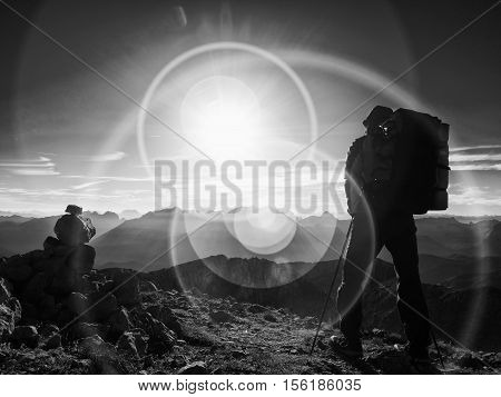 Lens Flare Defect.  Silhouette Of Man With Hodd, Backpack And Poles In Hand. Man Walk