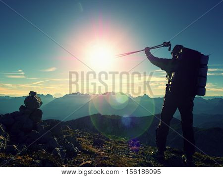 Lens Flare Defect. Happy Alone Adult Backpacker With Raised Poles