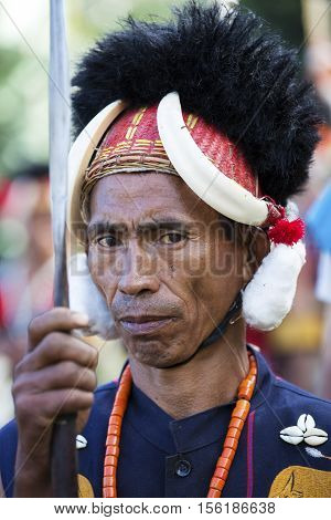 KOHIMA, NAGALAND/INDIA - DECEMBER 3, 2013: Tribes of Nagaland perform their traditional tribal dance at the annual Hornbill festival. The Hornbill is also known as the Festival of Festivals'.