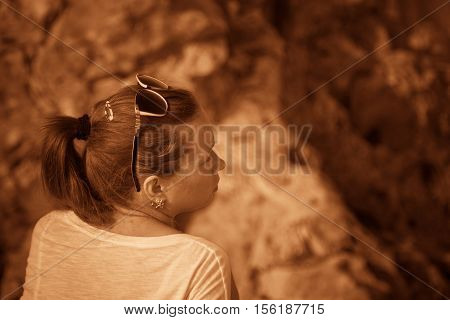 Girl on a hill in the desert. Ordinary people. Effect - Sepia. Nature Monument -Kamyshinskye Mountain Ears. Volgograd region Russia
