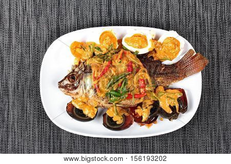 Curry-fried  Tilapia Fish With Preserved Egg And Salted Egg.