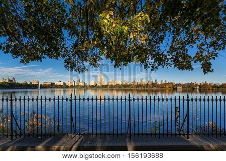 Fall in Central Park at the Jacqueline Kennedy Onassis Reservoir. Cityscape morning view with colorful autumn foliage. Upper West Side, Manhattan, New York City