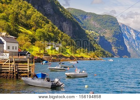 Boats In Undredal With The Fjord In The Background, Norway