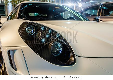 ABU DHABI - NOVEMBER 3 2016: Alfa Romeo 4C Coupe in Abu Dhabi. Detail of a 4C front light