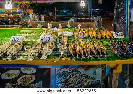 PATTAYA, THAILAND - 22 October 2016 : Street food seller selling seafood in the night market in Pattaya Thailand, Street food is ready-to-eat food or drinks sold by a hawker