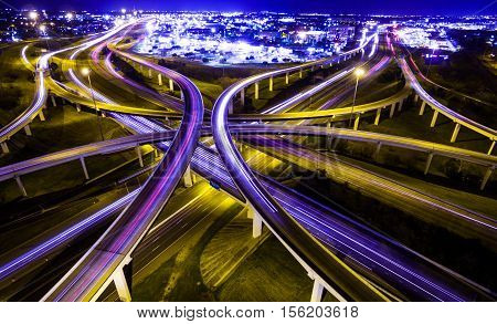 Mopac Expressway and Highway 183 Interchange Interstate Urban Timelapse Aerial View of Dramatic lights and brake lights Austin Texas USA