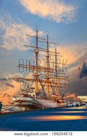 GDYNIA, POLAND - JUNE 04, 2010: People visit Polish training tall ship Dar Pomorza in Gdynia. The sailing frigate dating back to 1909 is a famous museum ship nowadays.