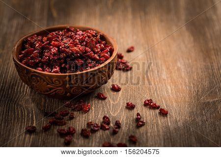 Dried Barberry (Berberis vulgaris) on wooden table