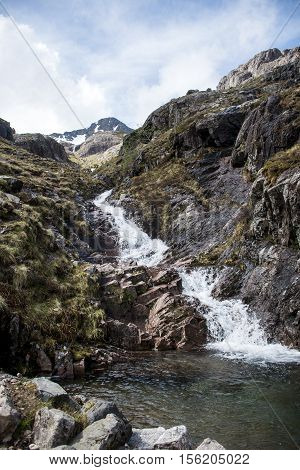 Glen Coe Highlands scotland in nature uphill crossing waterfall for panorama view