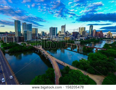 Austin Texas Blue Reflections sunset with Bridges and Modern Architecture builds a Progressive Capital City Aerial Over Downtown ATX