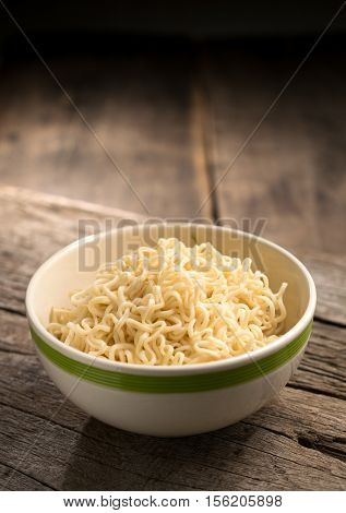 Instant Noodles In A Bowl On Wood Board.