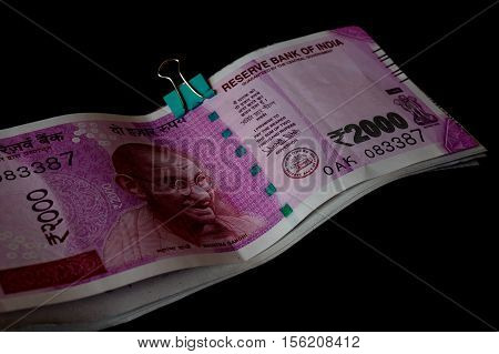 The new rupee 2000 currency notes introduced in india to curb black money. Isolated on black