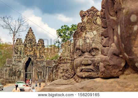 Siem Reap, Cambodia - February 1, 2016: Unidentified tourists visit to Angkor Thom. South gate to Angkor Thom and the faces of stone giants guarding the entrance.