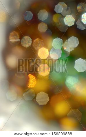 Christmas soft lights colorful background. Made with lens as out of focus image.