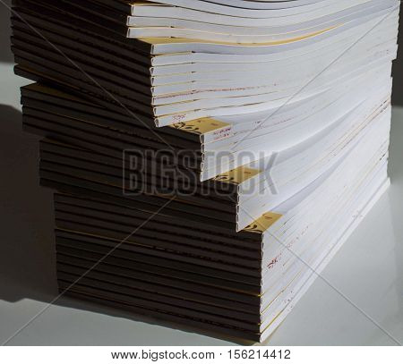 Great number of empty notebooks pile up