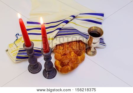 Table Set For Shabbat With Lighted Candles, Challah Bread And Wine.