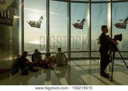 DUBAI UAE - NOVEMBER 8 2016: Tourists on Burj Khalifa tower. This skyscraper is the tallest man-made structure in the world measuring 828 m. Completed in 2009. people at the top the observation deck of the highest building in the world Burj al Khalifa