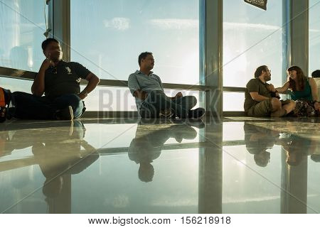 DUBAI UAE - NOVEMBER 8 2016: Tourists on Burj Khalifa tower. This skyscraper is the tallest man-made structure in the world measuring 828 m. people at the top the observation deck of the highest building in the world Burj al Khalifa