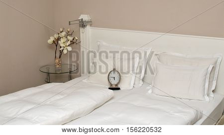 Alarm Clock On A Bed In Bedroom