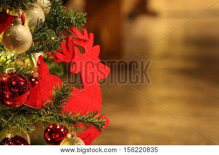 Christmas decoration with a red reindeer on brown background