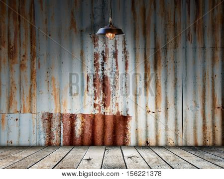 Lamp at Rusted galvanized iron plate with wood floor