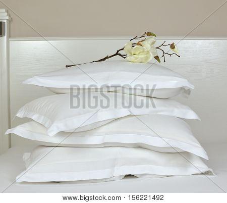 Pile Of White Sleeping Pillows