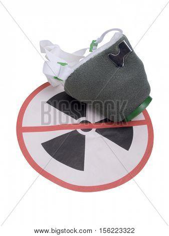 Protective mask on the background radiation danger sign