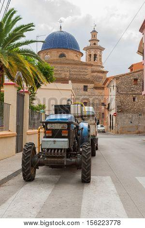 Xalo tractor parked in street scene Spain