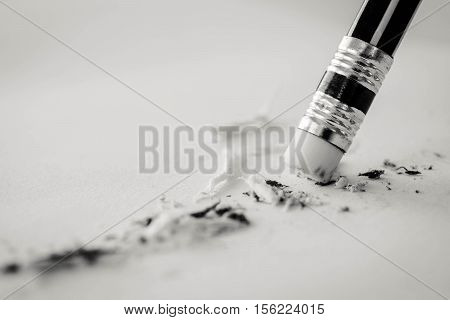 Pencil Eraser. Pencil Eraser Removing A Written Mistake On A Piece Of Paper, Mistake Concept, Black