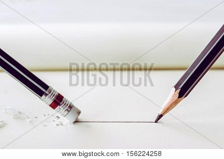 Pencil Draws A Straight Line On Paper And Pencil Eraser Removing Stripe. Business Breaking Concept.