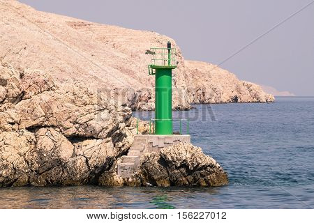 Lighthouse that signals the presence of rocks at passing ships.