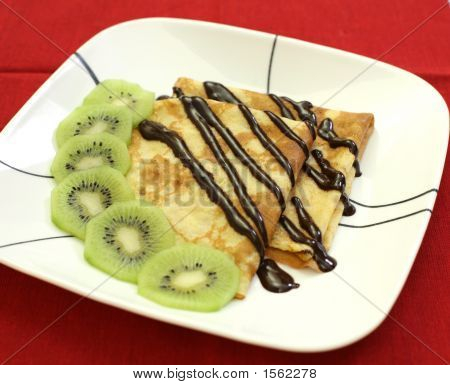 French Crepes With Chocolate And Kiwi Fruit