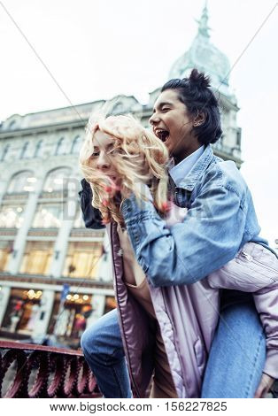 cute young couple of teenagers girlfriends having fun, traveling europe, modern fashion citylife, lifestyle real people concept close up