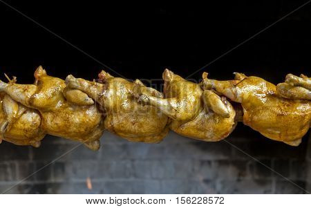 Chicken lamb and pig on spit barbecue