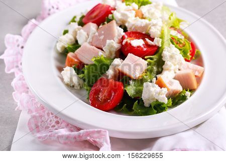Salad with smoked chicken breast feta and tomato