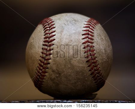Close up of professional sized well used and weathered baseball