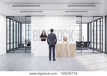 People are standing in an office lobby. Large wall is decorated with white tiles. There is a wooden part of it and two conference rooms by both sides. 3d rendering. Mock up