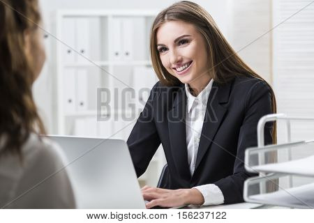 Woman Is Pleased To Work With Her Colleague