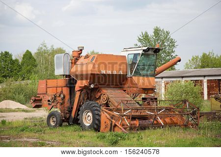 BAUSKA DISTRICT LATVIA - May 20 2016: Old harvester in Latvia near Bauska