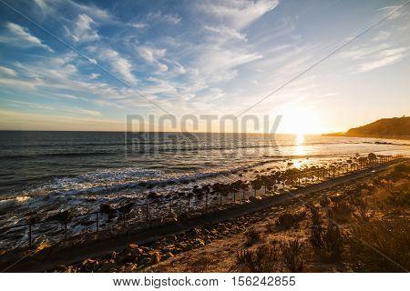a colorful sunset in Malibu in California