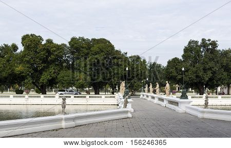 AYUTTHAYA, THAILAND - November 4, 2016: View of the bridge with standing neoclassical women statues on each balustrade at the Bang Pa-in Palace compound Thailand.